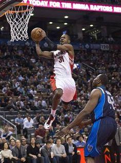 Toronto Raptors forward Terrence Ross, left, slam dunks the ball past Dallas Mavericks Elton Brand, right, during first half NBA basketball action in Toronto on Friday, Dec. 14, 2012. (AP Photo/The Canadian Press, Nathan Denette)