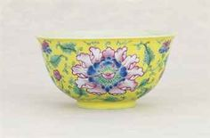 A FAMILLE ROSE YELLOW-GROUND 'PEONY' BOWL DAOGUANG SIX-CHARACTER SEAL MARK AND OF THE PERIOD (1821-1850) The bowl is potted with tall rounded sides rising to a flaring mouth rim, and is supported on a short foot. The exterior is enamelled with three large peony flowers surrounded by associated foliage, all reserved on a lemon-yellow ground. 4 ½ in. (11.4 cm.) diam.