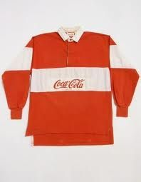 80s: Coca-Cola rugby shirts were big for a couple years.  Had one in blue and white with red Coca-Cola lettering, and one in green and white.