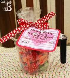 Teacher Valentines -fill up a measuring cup with candy for a useful and sweet gift!