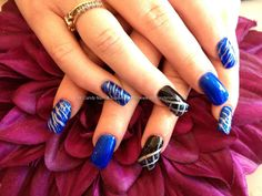 Acrylic nails with blue and black nail art