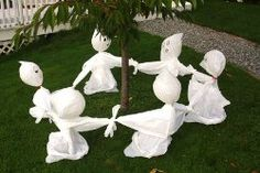 Halloween - Easy Craft Idea that looks fun - Garbage Bag Lawn Ghosts | AllFreeHolidayCrafts.com