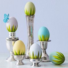 Create a landscape effect on each Easter egg with this fun grass design! Here's how: http://www.bhg.com/holidays/easter/eggs/quick-and-easy-easter-egg-decorations/#page=2