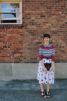 Striped sweater, abstract dotted skirt