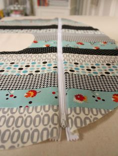 Putting a zipper in a boppy cover - Sew Lux Fabric and Gifts Blog: Design Challenge: Patchwork Boppy Cover Tutorial
