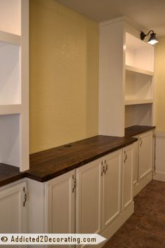 DIY built-in cabinets and bookcase wall - don't know that I could do this, but might try with the boys for the basement tv area