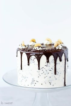 Banana and toffee with vanilla SMBC frosting, chocolate jimmies and chocolate ganache drip.