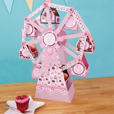 Create a show-stopping display for your best bakes with this fun Ferris wheel cupcake stand made with free download papers.