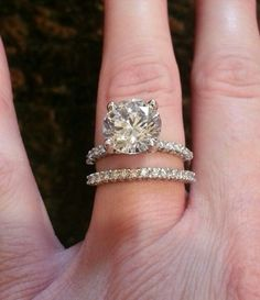 4 carat round cut solitaire engagement ring with infinity band wedding ring.