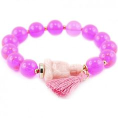 Das farbenfrohe Ethno-Armband Buddha aus Kugeln in Neon-Pink ist ein stylishes Accessoire vom beliebten Berliner Label RIO. Das Armband wurde aus robusten Acrylkugeln in Deutschland handgefertigt.