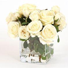 White roses in square glass vase