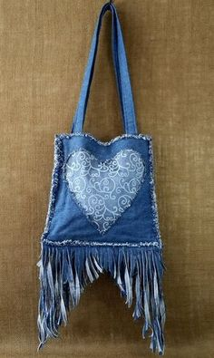 Hearts and lace, what can I say but Awesome! I used recycled materials, which I love, to make this purse.This is the perfect purse for those of you, like me, who LOVE fringe! All of my designs are unique and 100% handmade by Miss Thread. Thanks for checking out my designs. -Michele