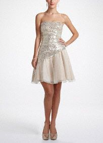 Prom to the perfect time to shine and you will in this twinkling sequin dress! Strapless bodice features ultra glamorous all over sequin detail. Side draping creates dimension and an elongated silhouette. Glittery full tulle skirt finishes off the look. Fully lined. Side zip. Imported polyester. Also available in plus sizes as Style 45879L . david's bridal