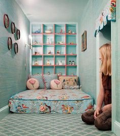 A Secret Playroom. The grass-cloth wallpaper and bed fabrics are from Brunschwig & Fils. The porcelain figurines were all found at flea markets. Artist Meghan Boody's Tribeca apartment .Image by Ofer Wolberger.