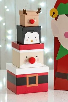 · Set of four various sized stacking character boxes in a fun novelty design. Mini reindeer box L 70 x W 70 x H small penguin box L 90 x x H medium Santa box L 120 x W 120 x H and… Christmas Present Wrap, Easy Diy Christmas Gifts, Christmas Gift Box, Christmas Makes, Christmas Gift Wrapping, Christmas Holidays, Christmas Crafts, Christmas Decorations, Christmas Ideas