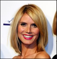 Long angled bob hair style. Straight, a little layered and jagged cut ends, swept to the side to compliment the face