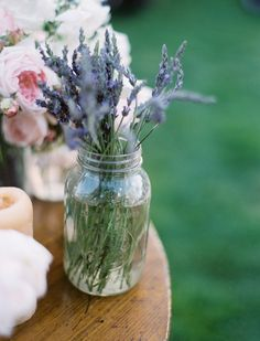 lavender in mason jars with river rocks | simple amp pretty lavender in mason jar as a bridal shower centerpiece ...