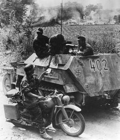 A dispatch rider passing information to the crew of a SdKfz 250 operating with the SS Division 'Wiking'