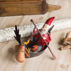 "Recycled Santa In A Moose Canoe Product Dimensions: 6"" x 9"" x 5""t"