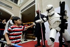 Philippines: A boy bumps fists with a clone trooper as they celebrate <em>Star Wars</em> Day in Pasay City, Metro Manila, Sunday.