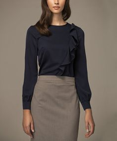 This breezy closet staple is an elegant work-to-weekend piece, featuring feminine frills for a chic, asymmetrical finish and a neutral hue for effortless pairing. Size note: This item runs small. Ordering one size up is recommended. Shipping note: This item is shipping from Europe. Allow extra time for its journey to you.