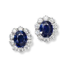 A Pair of Sapphire and Diamond Earclips   Centered by two oval-shaped sapphires, framed by round brilliant-cut diamonds, mounted in platinum, length ¾ in.