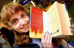 You'll never guess who this is...EVANNA LYNCH!!! :D With her autographed copy of Harry Potter and the Goblet of Fire! :D Love her! Look how cute she looks!