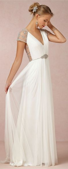 Sheer beaded open back flowing wedding dress