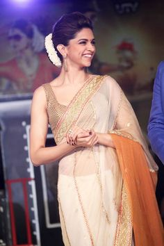 Deepika Padukone's beautiful smile. Love her saree and gajra look
