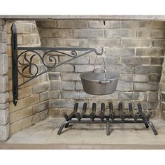 Features:  -Material: Wrought iron.  -Beautiful and functional utensil for hearth cooking.  -Pre-drilled for masonry anchor bolts.  -Black powder coated finish.  Product Type: -Fireplace tool.  Finish