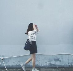 Striped shirt and skirt with sneakers