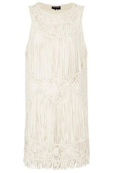 From TopShop - Looks really cute as a swimsuit cover-up....Cream Macrame Vest