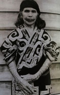 Ainu woman with tattooed lips and arms