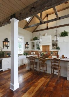 perfect kitchen..white cabinets with rustic beams and floors