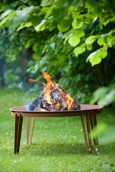 The sculptural firebowl is made of Corten steel, a weather-resistant, rust-inhibiting material. Ignis is not only light and airy t. Wood Steel, Corten Steel, Barbecue, Outdoor Heaters, Garden Games, Cottage In The Woods, Fire Bowls, Royal Design, Outdoor Living