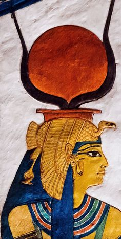 """Detail from the """"House of Eternity"""" of Queen Nefertari, QV66, west 'Uaset'-Thebes: the Goddess Hathor wearing the vulture headdress and the Solar disk with cow's horns, and the earring with the Uraeus"""