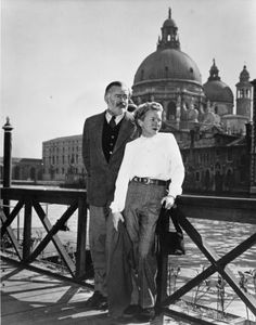 Ernest Hemingway and Mary Hemingway along a canal in Venice, 1950s