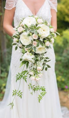 Bridal bouquet - we love those exact green creeping plants. however we dont like those flowers. Cascading Wedding Bouquets, Bride Bouquets, Bridal Flowers, Floral Bouquets, Floral Wedding, Wedding Boquette, Wedding Peach, Cascading Flowers, Long Flowers