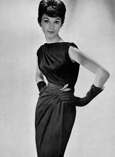 Model in fluid draped jersey cocktail dress by Carven, jewelry by Marcassite, photo by Georges Saad, 1959