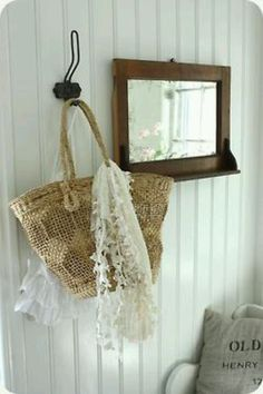 .love the scarf drape on the basket ... hanging on the hook