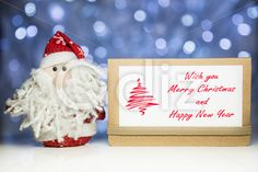 Qdiz Stock Images Santa Claus with Christmas greeting card,  #background #beard #brown #card #celebration #Christmas #Claus #Clause #closeup #craft #decoration #doll #eve #Father #figure #frost #fun #funny #greeting #holiday #lights #little #Merry #new #paper #postcard #red #Santa #small #toy #traditional #white #xmas #year