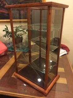 Wood and Glass Display Case for Miniatures, Models, Crystal Figurines - Asian Merrbau (other exotic woods available) by ChameleonWood on Etsy https://www.etsy.com/listing/231241258/wood-and-glass-display-case-for