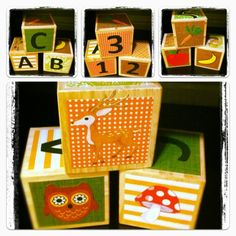 Mod Podge scrap book paper on blocks so you can pick the theme/color scheme to go with the room decor