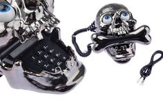 Skull Skeleton Shaped Cored Telephone Phone [amazon]  Novelty wired desk telephone with cool skull shaped. It can be used as a telephone or as a decoration in your family or office. Novel design, skull telephone with jumping eyes Pulse/Tone switch Last number redial
