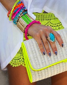 Neon shorts, stacked bracelets, and flawy top = festival perfection