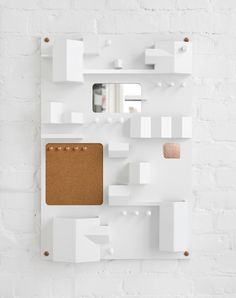 Suburbia Modern Wall Storage - Design Milk. Made from wood to resemble aerial view of a town.