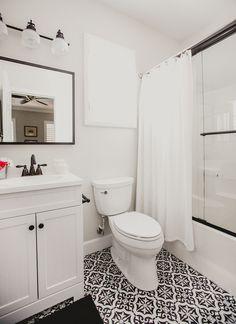 White bathroom classic bathroom merola tile lowes vanity bathroom design to Lowes Bathroom, Bathroom Renos, Bathroom Flooring, Bathroom Furniture, Bathroom Interior, Vanity Bathroom, Bathroom Caddy, Tile Flooring, Black White
