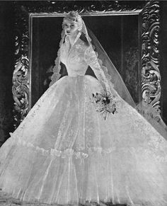 Wedding dress made from English Nottingham lace, from an advertisement for Alexandrine, 1956.