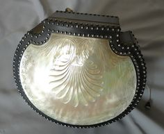stock number 4622   Antique Palais Royal engraved mother of pearl and steel work shell shaped musical sewing necessair