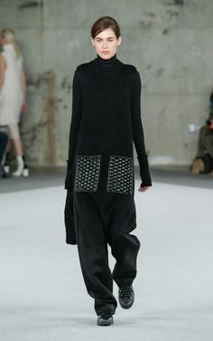 Fall 2014 | EDUN | Look 25 | Tunic with Leather Woven and Faux Fur Pockets, Wool Turtleneck with Ribbed Cuff, Wool Pleated Wide Leg Pant, Adidas Original Customized by EDUN